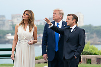 President Donald J. Trump and First Lady Melania Trump arrive to the G7 Leaders' Working Dinner and are greeted by French President Emmanuel Macron and his wife Mrs. Brigitte Macron Saturday, Aug. 24, 2019, at the Phare de Biarritz in Biarritz, France. (Official White House Photo by Andrea Hanks)