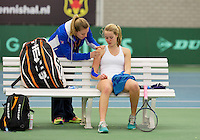 March 15, 2015, Netherlands, Rotterdam, TC Victoria, NOJK, Nina Kruijer (NED) is being treated for an injury by fysio therapist  Annelies Geel <br /> Photo: Tennisimages/Henk Koster