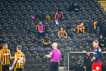 Hull City's substituted players and unused substitutes watch the game from the stand. Hull 2 Sunderland 2, League One 20th April 2021.