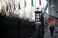 CHINA. Shanghai. Muslim men near the Oriental Pearl Tower. Shanghai is a sprawling metropolis or 15 million people situated in south-east China. It is regarded as the country's showcase in development and modernity in modern China. This rapid development and modernization, never seen before on such a scale has however spawned countless environmental and social problems. 2008.