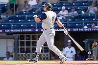 Dallas McPherson #8 of the Charlotte Knights follows through on his swing against the Durham Bulls at Durham Bulls Athletic Park on August 28, 2011 in Durham, North Carolina.   (Brian Westerholt / Four Seam Images)
