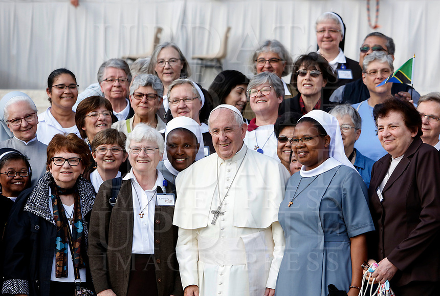 Pope Francis poses with a group of faithful at the end of his weekly general audience in St. Peter's Square at the Vatican City, October 16, 2019.<br /> UPDATE IMAGES PRESS/Riccardo De Luca<br /> <br /> STRICTLY ONLY FOR EDITORIAL USE