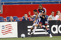 Pachuca CF midfielder Paul Nicolas Aguilar (22) and New England Revolution midfielder Khano Smith (18). The New England Revolution defeated Pachuca CF 1-0 during a Group B match of the 2008 North American SuperLiga at Gillette Stadium in Foxborough, Massachusetts, on July 16, 2008.