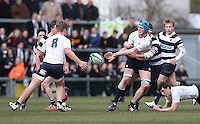 MCB vs Wallace High School | Thursday 5th March 2015<br /> <br /> Scott McClellan passes to Zac Jordan during the 2015 Ulster Schools Cup Semi-Final between Methody and Wallace High School at the Kingspan Stadium, Ravenhill Park, Belfast, Northern Ireland.<br /> <br /> Picture credit: John Dickson / DICKSONDIGITAL