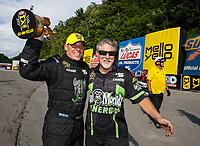 Jun 18, 2017; Bristol, TN, USA; NHRA pro stock driver Alex Laughlin (left) celebrates with father Kenny Laughlin after winning the Thunder Valley Nationals at Bristol Dragway. Mandatory Credit: Mark J. Rebilas-USA TODAY Sports