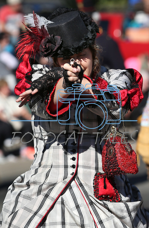 A member of the Mayfield Gang takes aim during the 75th annual Nevada Day parade in Carson City, Nev., on Saturday, Oct. 26, 2013.<br /> Photo by Cathleen Allison