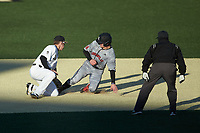Luke Brown (8) of the Louisville Cardinals slides into second base ahead of the tag attempt by DJ Poteet (4) of the Wake Forest Demon Deacons as umpire Fred Cannon looks on at David F. Couch Ballpark on March 7, 2020 in  Winston-Salem, North Carolina. The Demon Deacons defeated the Cardinals 3-2. (Brian Westerholt/Four Seam Images)