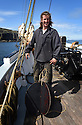 THE BESSIE ELLEN TRAVEL FEATURE.<br /> The crew lower the sails off the island of Lunga in the Inner Hebrides, Scotland.<br /> Fulltime crew member James Steevenson, 24.<br /> Photo:Clare Kendall<br /> 24/05/2016