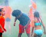BEACON FALLS, CT. - 19 July 2021-071921SV04-Kids from the United Day School summer program get sprayed by firefighters from Beacon Hose Co. No. 1 during a water day at the Pent Road Recreation Center in Beacon Falls Monday.<br /> Steven Valenti Republican-American