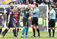 FC Barcelona's Victor Valdes have words with the referee Miguel Angel Perez Lasa in presence of Gerard Pique (l), Andres Iniesta (2l) and Jordi Alba (3l) after La Liga match.March 02,2013. (ALTERPHOTOS/Acero) /NortePhoto