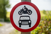 No vehicles sign with a family drawn in the car at Amroth, Pembrokeshire, Wales, UK