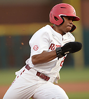 Arkansas center fielder Christian Franklin heads to the plate Tuesday, April 6, 2021, on an RBI single by short stop Jalen Battles during the second inning of play against UALR at Baum-Walker Stadium in Fayetteville. Visit nwaonline.com/210407Daily/ for today's photo gallery. <br /> (NWA Democrat-Gazette/Andy Shupe)