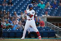 Lency Delgado (5) of the Kannapolis Cannon Ballers at bat against the Charleston RiverDogs at Atrium Health Ballpark on June 30, 2021 in Kannapolis, North Carolina. (Brian Westerholt/Four Seam Images)
