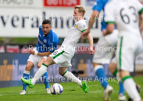 St Johnstone v Celtic...15.05.15   SPFL<br /> Gary Miller clears from Gary Mackay-Steven<br /> Picture by Graeme Hart.<br /> Copyright Perthshire Picture Agency<br /> Tel: 01738 623350  Mobile: 07990 594431