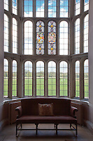A lead-paned bay window in the older part of the hall looks out over parkland with grazing sheep