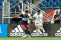 FOXBOROUGH, MA - AUGUST 7: Damian Rivera #72 of New England Revolution II dribbles as Mateo Rodas #63 of Orlando City B defends during a game between Orlando City B and New England Revolution II at Gillette Stadium on August 7, 2020 in Foxborough, Massachusetts.