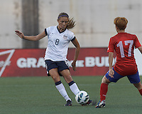 USWNT defender Kristie Mewis (8) passes the ball.  In an international friendly, the U.S. Women's National Team (USWNT) (white/blue) defeated Korea Republic (South Korea) (red/blue), 4-1, at Gillette Stadium on June 15, 2013.