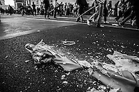 A statue of Virgin Mary looted from a nearby church is broken into pieces by black bloc  fringes  during the national rally of 15 Oct.. 2011. Rome, Italy