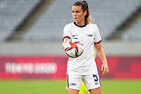 TOKYO, JAPAN - JULY 21: Kelley O'Hara #5 of the United States picks up the ball during a game between Sweden and USWNT at Tokyo Stadium on July 21, 2021 in Tokyo, Japan.