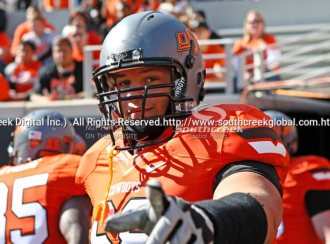 Oklahoma State Cowboys offensive linesman Lane Taylor (68) in action during the game between the Baylor Bears and the Oklahoma State Cowboys at the Boone Pickens Stadium in Stillwater, OK. Oklahoma State defeats Baylor 59 to 24.
