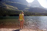 Heidi Wickersham prepares for a swim in Glacier National Park, Montana, USA.