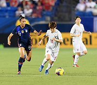 FRISCO, TX - MARCH 11: Lynn Williams #13 of the United States battles for control of the ball with Riko Ueki #11 of Japan during a game between Japan and USWNT at Toyota Stadium on March 11, 2020 in Frisco, Texas.
