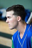 Right fielder Cal Jones (9) of the Lexington Legends in the dugout before a game against the Greenville Drive on Saturday, September 1, 2018, at Fluor Field at the West End in Greenville, South Carolina. Greenville won, 9-6. (Tom Priddy/Four Seam Images)