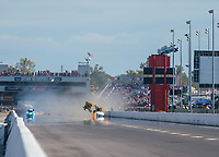 Sep 23, 2018; Madison, IL, USA; NHRA funny car driver Robert Hight explodes the body off his car alongside Tim Wilkerson  during the final round of the Midwest Nationals at Gateway Motorsports Park. Hight walked away from the incident. Mandatory Credit: Mark J. Rebilas-USA TODAY Sports