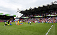 Pictured: Swansea players warm up prior to kick off<br />
