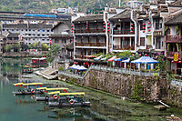 Zhenyuan, Guizhou, China.  Wuyang River View.  Apartment Buildings.  Freight Train in Upper Left.