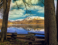 Fence and reflection in Snake River at Farewell Bend State Park, Oregon