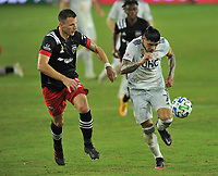 WASHINGTON, DC - SEPTEMBER 27: Gustavo Bou #7 of New England Revolution battles for the ball with Frederic Brilliant #13 of D.C. United during a game between New England Revolution and D.C. United at Audi Field on September 27, 2020 in Washington, DC.
