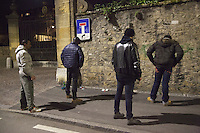 """Switzerland. The Republic and Canton of Neuchâtel. Neuchâtel. Narcotics squad. """"Narko"""" operation. Two police officers on duty (both in plain-clothes) keep an eye on and control identities of two men from Western Africa. The policemen look for illegal substances (drugs). Both black men will be left free at the end of the control. Plainclothes law enforcement is a method used by police. The policemen wear plainclothes or """"ordinary clothes"""" instead of a uniform in order to avoid detection or identification as law enforcement agents. Police officers in plainclothes must identify themselves when using their police powers. 28.03.15 © 2015 Didier Ruef"""