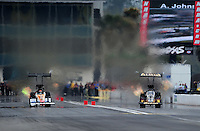 Mar. 11, 2012; Gainesville, FL, USA; NHRA top fuel dragster driver Khalid Albalooshi (right) races alongside Clay Millican during the Gatornationals at Auto Plus Raceway at Gainesville. Mandatory Credit: Mark J. Rebilas-