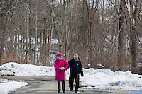 Diane Booher (left) walks with her older brother Ronnie Russo, 60, outside the residences in Malone Park at the Fernald Developmental Center in Waltham, Massachusetts, USA.  Ronnie and his twin Randy, both blind and unable to speak, have lived at the Fernald Center for 55 years.