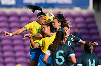 ORLANDO, FL - FEBRUARY 18: Beatriz #16 and Rafaelle #4 of Brazil go up for a header with Agustina Barroso #2 and Clarisa Huber #8 of Argentina during a game between Argentina and Brazil at Exploria Stadium on February 18, 2021 in Orlando, Florida.