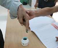TUNIS, TUNISIA - OCTOBER 6: Tunisian man's inked finger is seen after casting his vote at a polling station during the parliamentary elections in Tunis, Tunisia on October 6, 2019.
