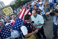 USA fans are interviewed by the media before the United States played Guatemala at Estadio Mateo Flores in Guatemala City, Guatemala in a World Cup Qualifier on Tue. June 12, 2012.