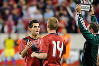 Carlos Bocanegra (5)  of the United States is subbed out for Tim Ream (14). The men's national team of the United States (USA) was defeated by Ecuador (ECU) 1-0 during an international friendly at Red Bull Arena in Harrison, NJ, on October 11, 2011.