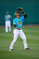 Lansing Lugnuts shortstop Otto Lopez (2) prepares to catch a pop fly during a Midwest League game against the Beloit Snappers at Cooley Law School Stadium on May 4, 2019 in Lansing, Michigan. The Lugnuts wore their Copa de la Diversión jerseys, becoming the Lansing Locos for the evening. Beloit defeated Lansing 2-1. (Zachary Lucy/Four Seam Images)