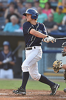 Asheville Tourists second baseman Michael Benjamin #18 swings at a pitch during a game against the Kannapolis Intimidators at McCormick Field on June 7, 2014 in Asheville, North Carolina. The Tourists defeated the Intimidators 7-5. (Tony Farlow/Four Seam Images)