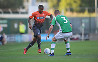 Luciano Narsingh of Swansea City battles with Carl Dickenson of Yeovil Town during the Pre-Season Friendly between Yeovil and Swansea City at Huish Park, Yeovil, England, UK. Tuesday 10 July 2018