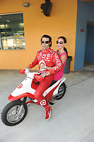 HOMESTEAD, FL - OCTOBER 01: Dario Franchitti of Scotland, driver of the #10 Target Chip Ganassi Racing Dallara Honda talks with his wife Ashley Judd during qualifying for the IZOD IndyCar Series Cafes Do Brasil Indy 300 at Homestead-Miami Speedway. Dario went on to win the pole position.  on October 1, 2010 in Homestead, Florida<br /> <br /> <br /> People:  Ashley Judd_Dario Franchitti