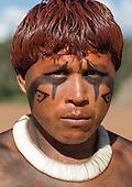 Xingu Indigenous Park, Mato Grosso State, Brazil. Aldeia Waura. Payapakuma Waura with beautiful shell necklace looking angry.
