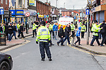 © Joel Goodman - 07973 332324 . 03/03/2012 . Heywood , UK . Police disperse demonstrators after the National Front hold a rally in protest against an alleged paedophile ring that had been operating in the area . There is currently (3rd March 2012) a case being tried at Liverpool Crown Court in relation to the allegations . Last Thursday (23rd February 2012) a protest organised in the town in relation to the same story resulted in Asian business being attacked by an angry mob . Photo credit : Joel Goodman