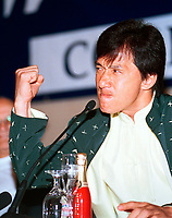 HK actor and director Jackie Chan  close his fist as he  speak about his work, in a press conference  before receiving a Special Grand Prize of the Americas, from <br /> Montreal World Film Festival's President & founder ; <br /> Serge Losique, Sept 1st , 2001 in Montreal, CANADA.