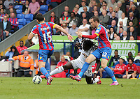 Pictured: Bafetimbi Gomis of Swansea (C) against Mile Jedinak (L) and Jordon Mutch (R) of Crystal Palace <br />