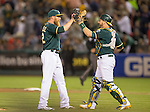 Sean Doolitle and Stephen Vogt celebrate the win.<br /> Boston Red Sox at Oakland A's at O.Co coliseum in Oakland, June 20, 2014