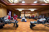 """DonCope of Rogers (from left) and Shayla Aschwanden of Eagel Rock, Mo. sit as they give blood, Monday, October 12, 2020 at the John Q. Hammons Convention Center in Rogers. The American Red Cross is hosting a week long blood drive with the goal of collecting over 500 units, 100 units a day, of blood. They are making up for a shortage since they cannot collect at high schools and colleges this year due to the pandemic. """"We have seen an increase in donors, we just don't have the places to host the drive,"""" said Cassady Watkins, account manager.""""The increase in donors is mainly due to the fact that we're providing free covid antibody testing."""" Donors can find out if they have covid-19 antibodies in 7-10 days through the Red Cross donor portal. The blood drive will be from 9 am to 5 pm all week ending on Friday. Check out nwaonline.com/2010013Daily/ for today's photo gallery. <br /> (NWA Democrat-Gazette/Charlie Kaijo)"""