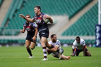 Javier Ortega Desio of Buenos Aires is tackled by Chris Rose of New York City during the World Club 7s at Twickenham on Sunday 18th August 2013 (Photo by Rob Munro)